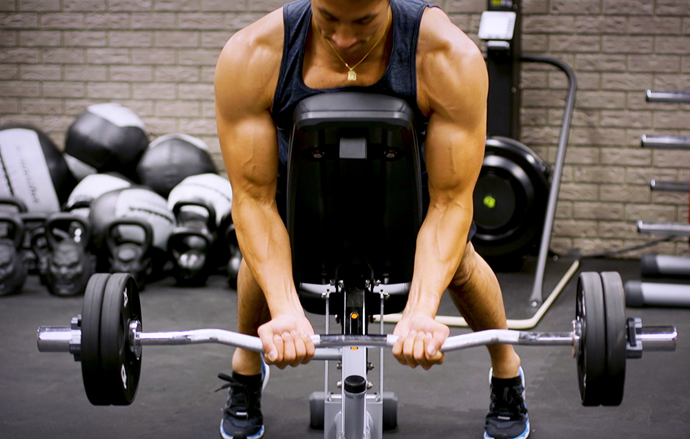 Perfect Your Biceps With the EZ-Bar Spider Curl | Men's Health
